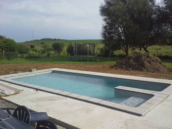 Prix d'une piscine enterrée couverte : Comparez les prix des Piscinistes